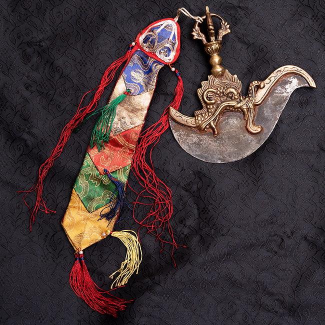 カルタリ(曲刀)のお守りの写真