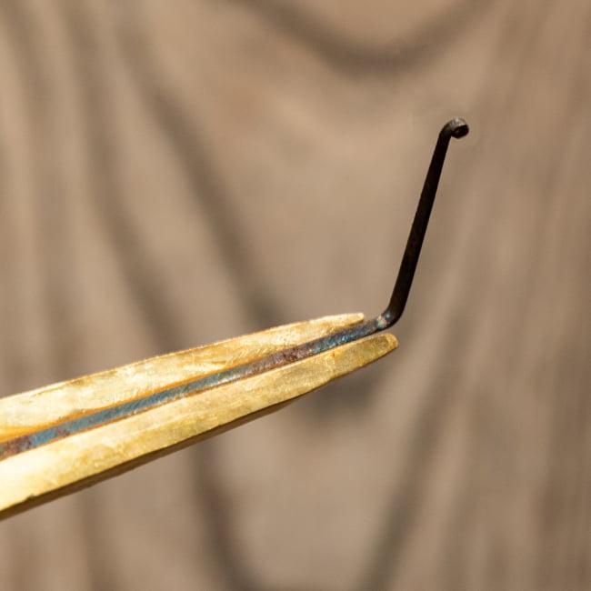 ネパールの真鍮製口琴[約9.5~10cm]の写真2 - 下記サイズ一覧のSサイズと比較してみました。