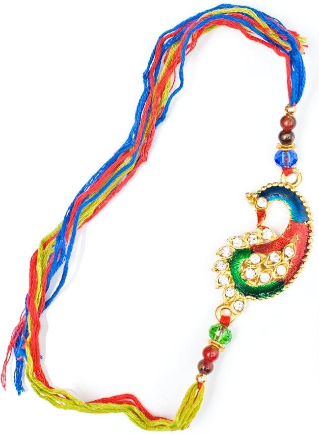 ラーキー  インドからきた紐のブレスレットの写真