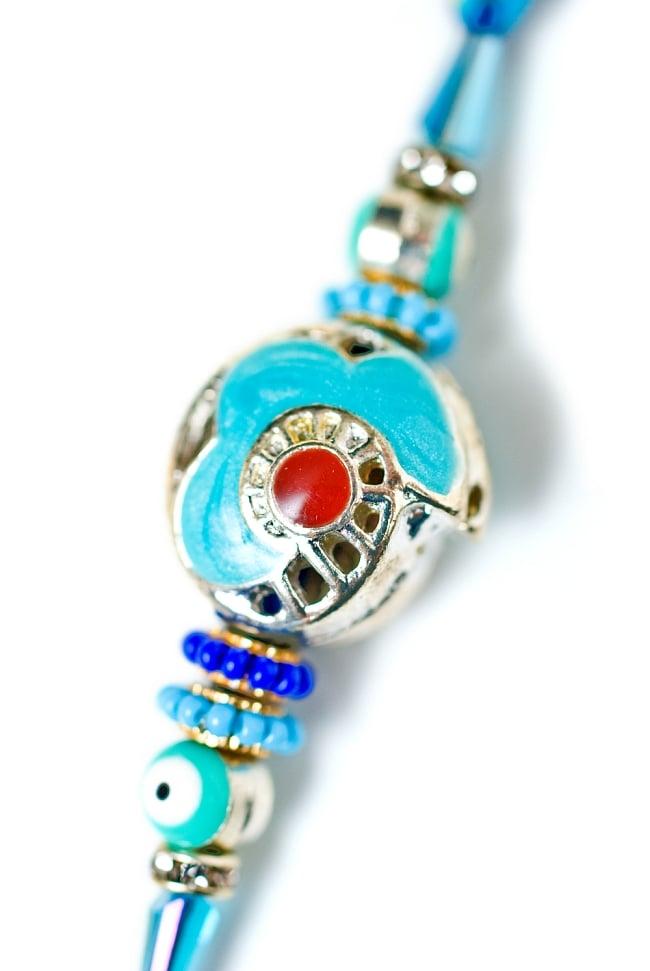 ナザール・ボンジュウのシンプル紐ブレス 2 - 装飾部分をアップにしてみました。