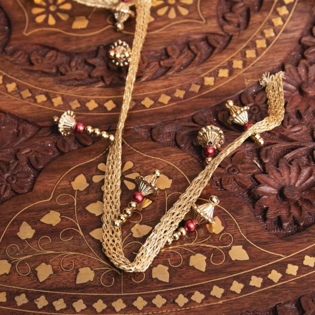 チロリアンテープ メーター売 - 華やかな金色のビーズ装飾 ベリーダンスなどへオススメ〔幅:約3.5cm〕 5 - 裏面はこのようになっております