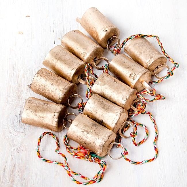 ドアチャイムなどへ!手作りのやさしい音色 インドの銅製カウベル-【4.5cm*3cm*120cm】の写真