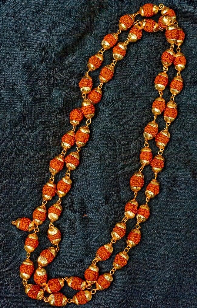 金色の菩提樹の数珠(小粒)- 約80cmほどの写真