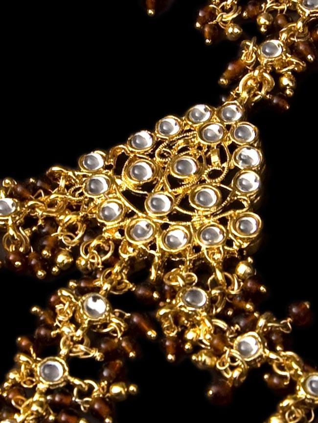 ゴールドパンジャ [3本指]の写真3 - 中心部分の装飾を拡大してみました。