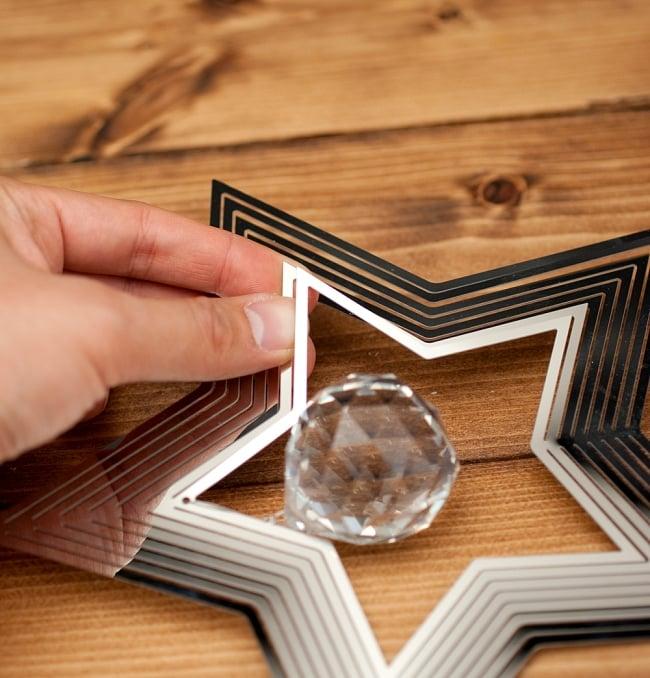 コスモスピナー 太陽で輝き風で動くモビール - スターの写真6 - 折り曲げることができるようになっています