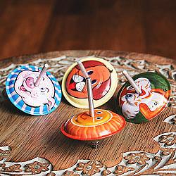 〔アソート〕バネつきで飛び跳ねるピョンピョンコマ インドのレトロなブリキのおもちゃ