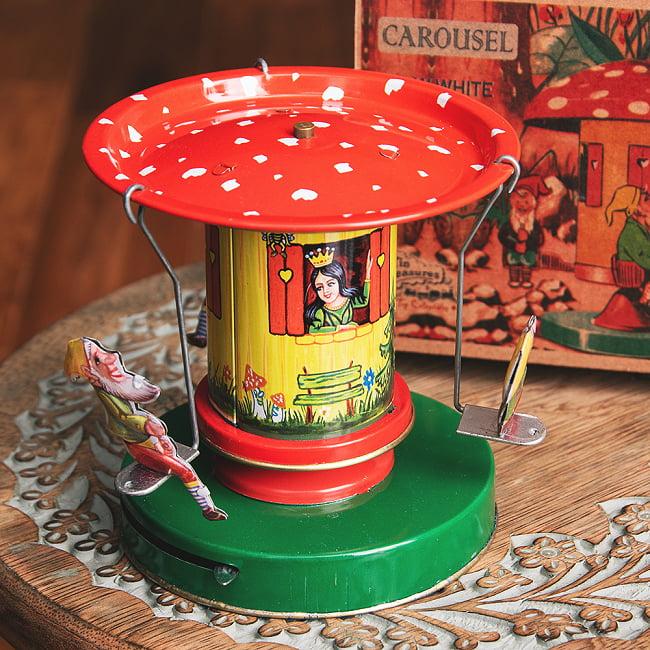 お姫様とドワーフたちの回転ブランコ インドのレトロなブリキのおもちゃ 1