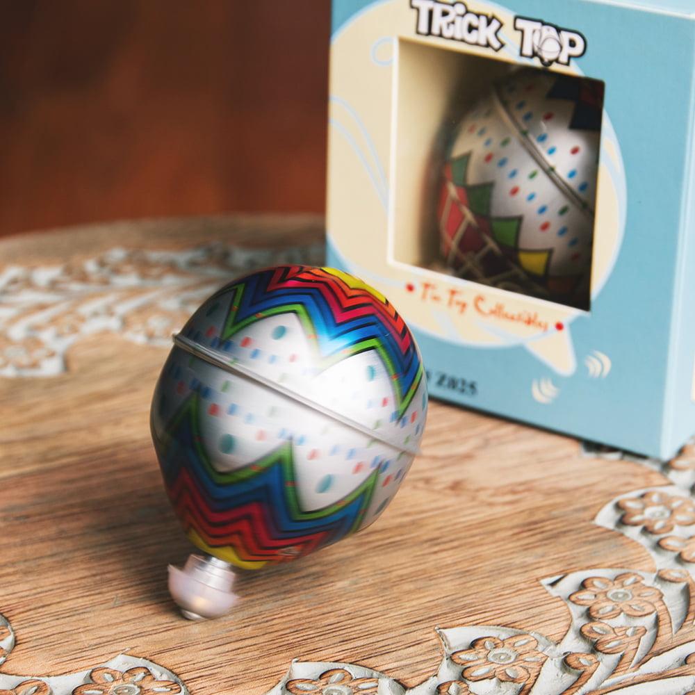 〔アソート〕フリクション式 カラフル気球コマ インドのレトロなブリキのおもちゃの写真