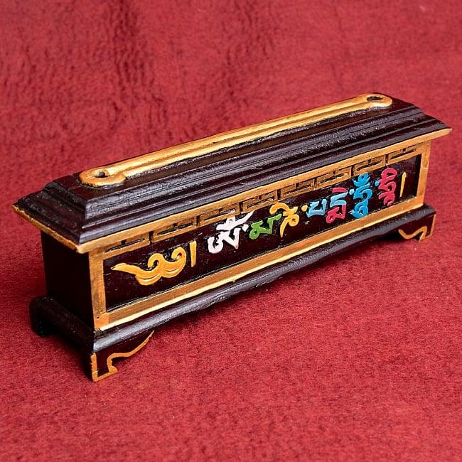 木彫りのチベタン香立て【オンマニペメフム】の写真