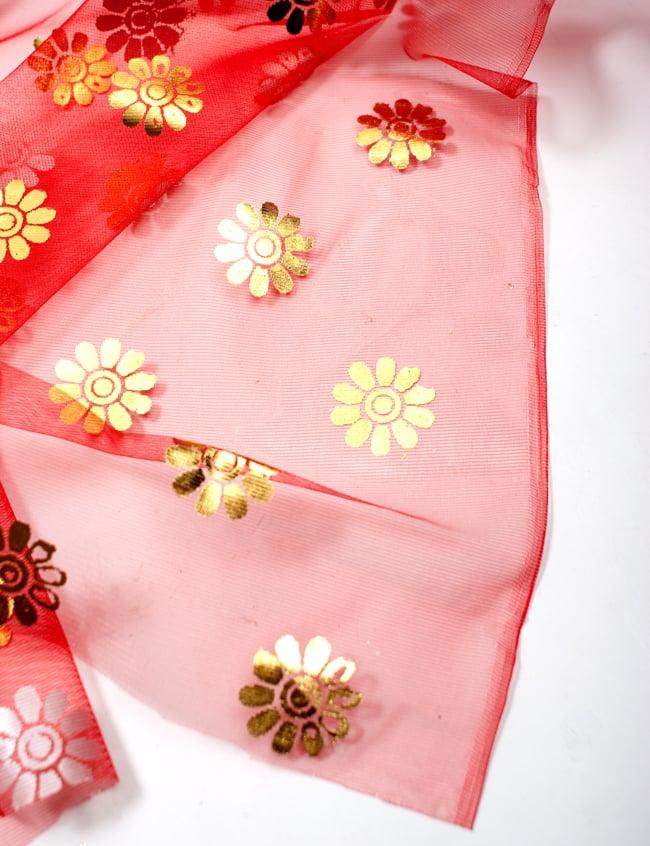 〔1m切り売り〕ゴールド花柄プリントのメッシュ生地布〔幅約110cm〕 - 赤の写真4 - フチの写真です