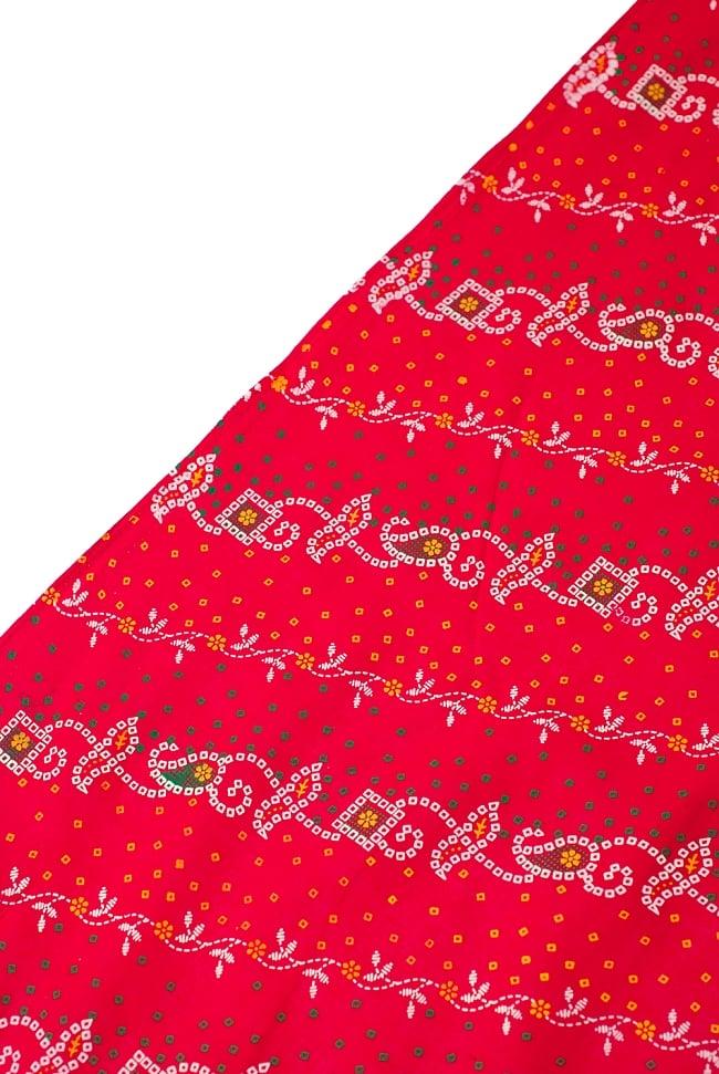 〔1m切り売り〕インドのバンディニ風プリント布 - 赤〔幅約105cm〕 3 - 端の部分の処理です。