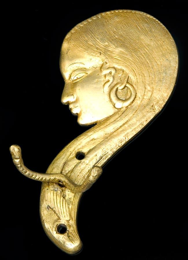 インドの女性の衣類ハンガー [金]の写真