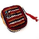 ネパールの手編みポーチ【黒・オレンジ・赤・白】