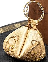 マハラーニ風の丸型おりたたみハンドバッグ - クリーム系
