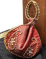 マハラーニ風の丸型おりたたみハンドバッグ - エンジ系