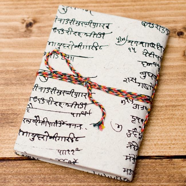 〈10cm×7.5cm〉インドの神様柄紙メモ帳 - 象 2 - 裏面の写真です