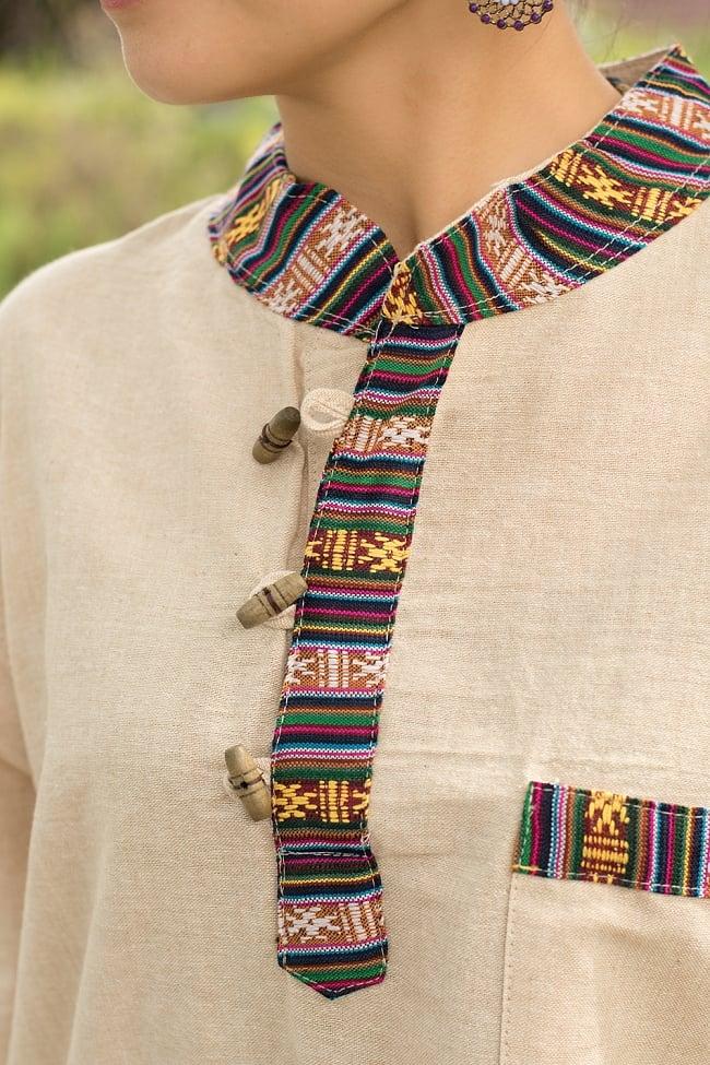 ブータン織 コットンクルタ 4 - 首周りや胸ポケット、裾口にネパール・ブータン特有の飾り布が用いられています。