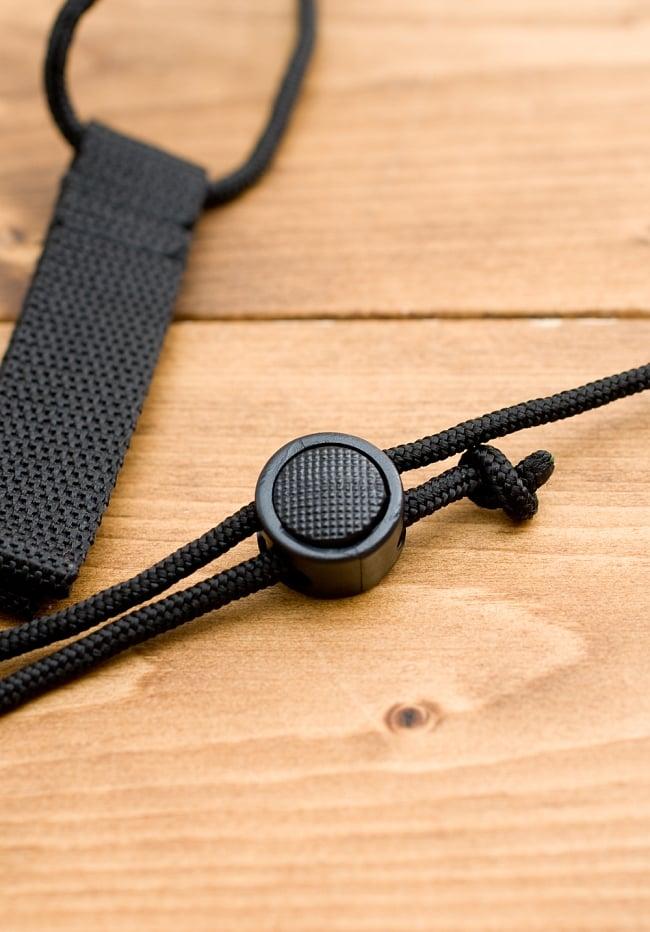 タコポイ【ストラップ部分がナイロン】 3 - 円形のものを押しながら紐を引くことで長さの調節が可能です
