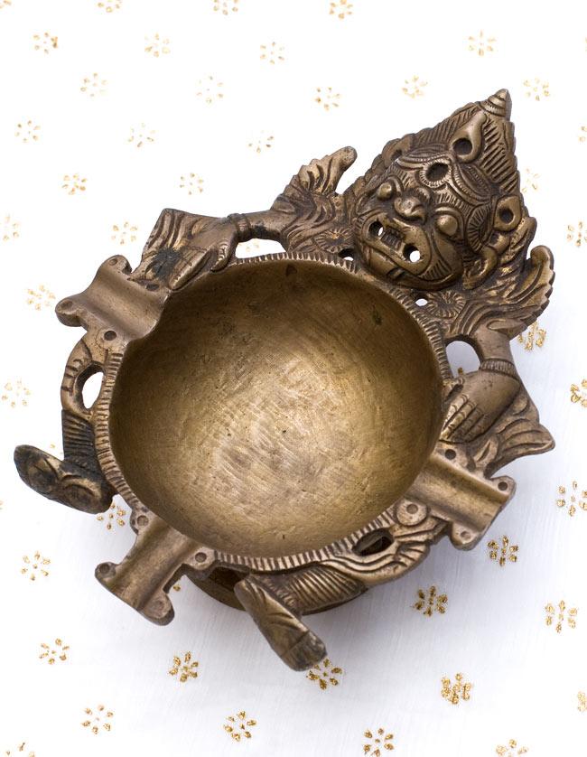 ブラスの神様灰皿の写真